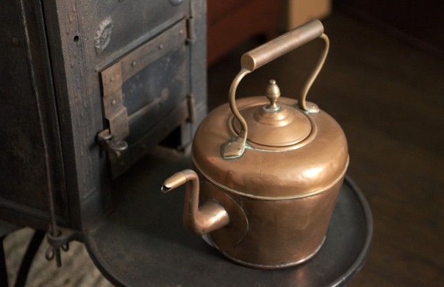 a-copper-tea-kettle-on-the-stove